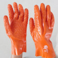 Orange pvc coated gloves chips on the palm