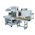 Cuff type automatic sealing shrink packaging machine