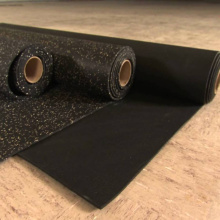 Shock absorbing rolled rubber flooring adhesive