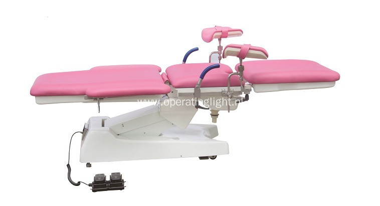 Red color gynecology table for obstetric examination