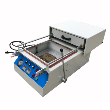 Small plastic vacuum forming machine