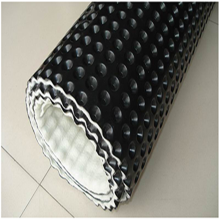 Composite drainage board with filament geotextile