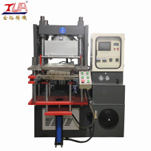 Vertical rubber compression molding machine with vacuum pump