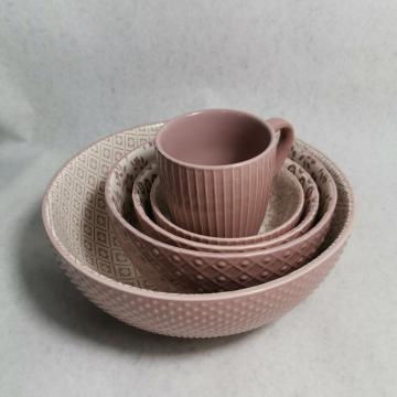 Embossed stoneware mugs and bowls