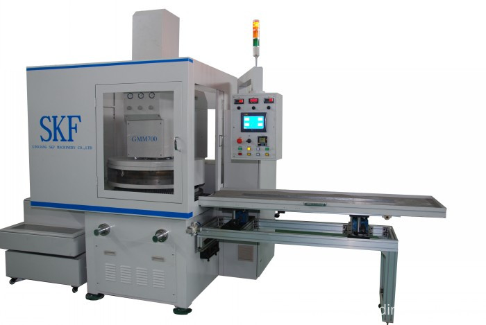 Double disk grinding machine for oil seals