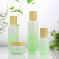 High-grade Cosmetic Gradient green glass bottles/jars with wood grain cap