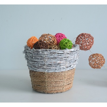 Round rattan and seagrass flower pot