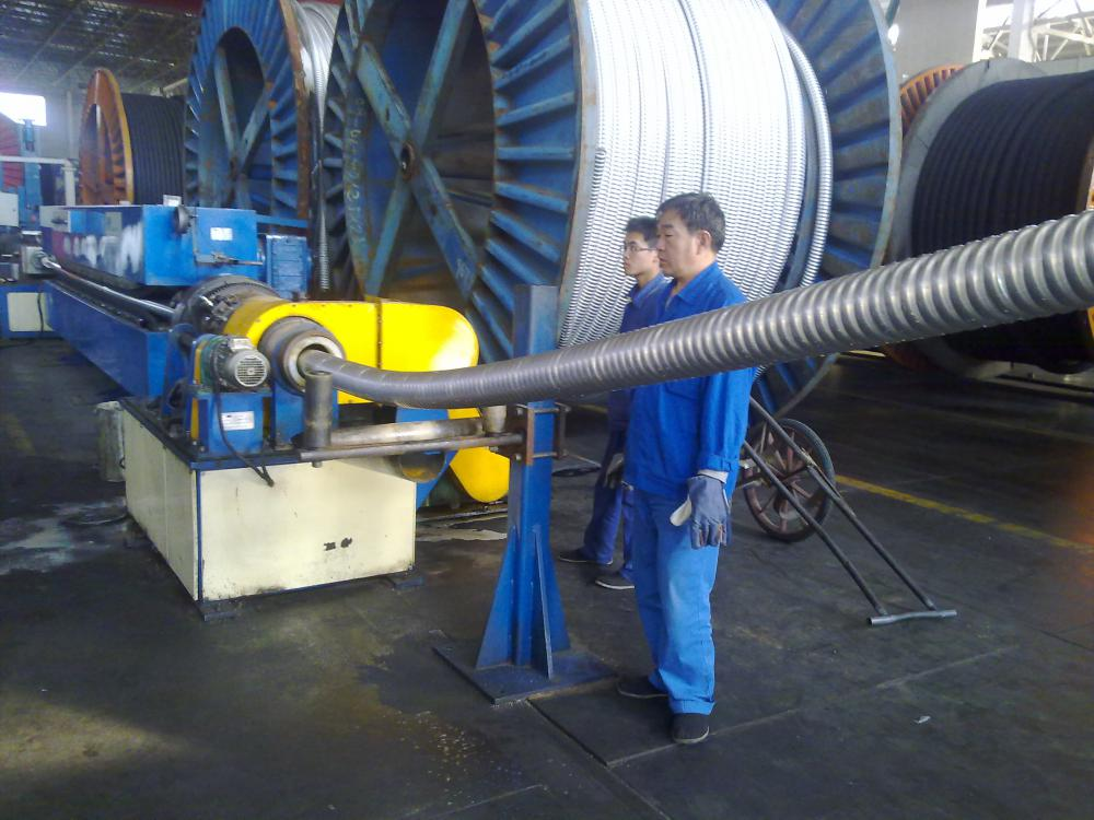 CORRUGATED ALUMINIUM ARMOUR MACHINE