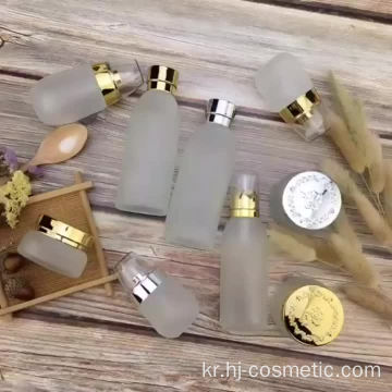wholesales High-grade golden carved ABS cap transparent glass cosmetic bottles/jars with good price