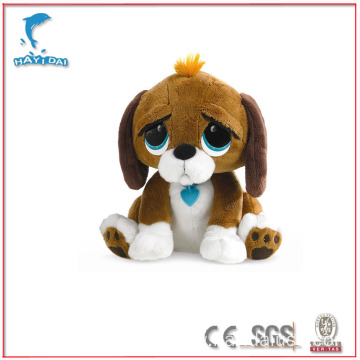 Plush brown and white sorrowful dog