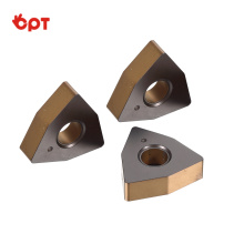 Tungsten carbide sharpened jaw inserts for wood turning