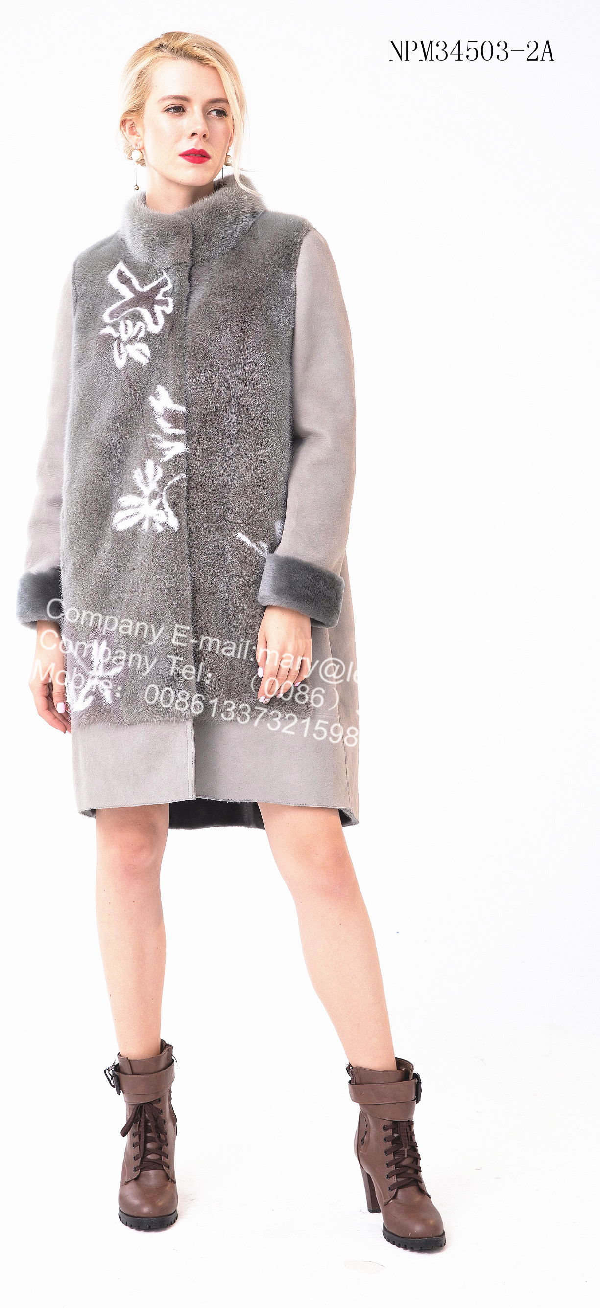 Medium shorn sheepskin fur coat with youthful breath.The design is novel, from the collar to the front door is the very soft shorn sheepskin fur.We can see very thick and delicate fur. With the mink flower decoration is very beautiful. The fur at the collar that wrap around your neck warms your skin and warms your heart. Sleeves can be turned up to look neat and tidy. What's more the inconsistent lower hem design,combine with current fashion elements to make you a beautiful landscape in winter