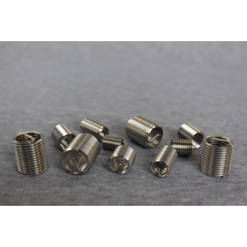 LOCKING SLOTTED INSERTS FOR METALS