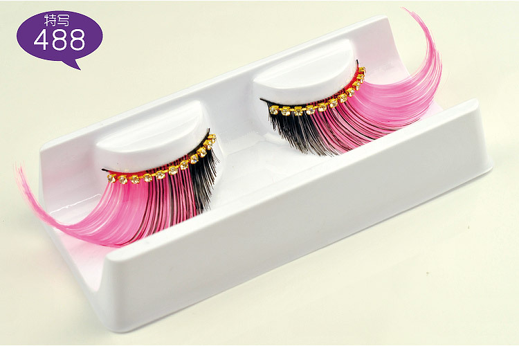 Exaggerated false eyelashes with diamond for show