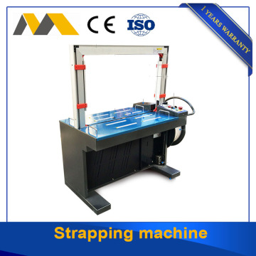 Strapping machine with iron arch automatic control system