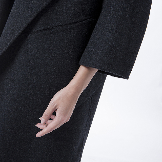 The sleeves of fashionable black winter clothes