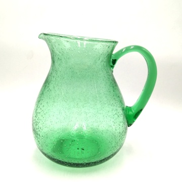 green glass carafe champagne coupe flute with bubble