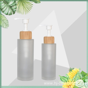 wholesale Frost 150ml 100ml glass bottle with bamboo wooden lotion sprayer pump Customized Made Cosmetic packaging