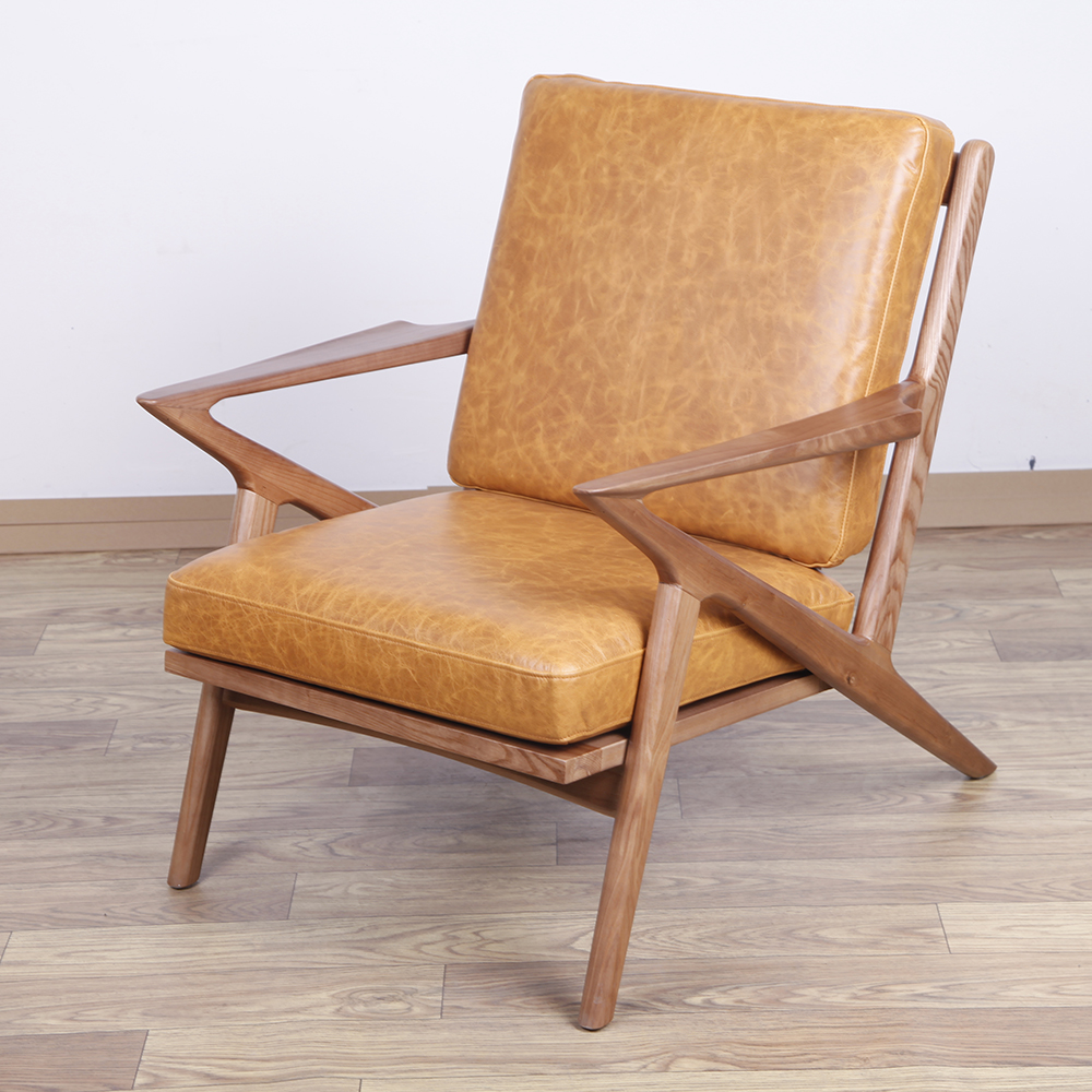 Waxy leather Selig lounge chair