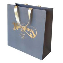 Golden foil shopping bags white kraft color paper
