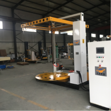Pallet wrapping machine with top sheet cover