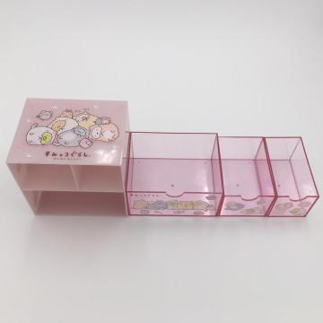 Plastic storage container with drawers