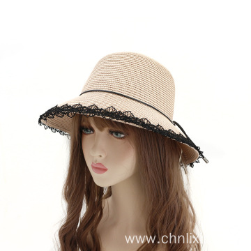 Tassels around straw hat top cover cap