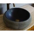 Round honed natural black lava sink