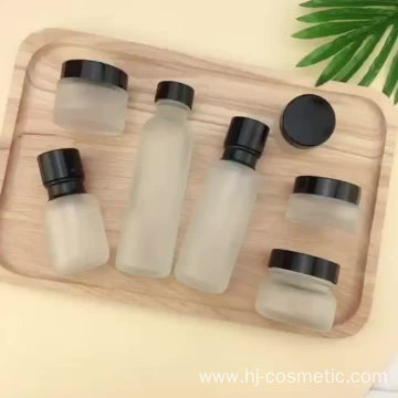 Wholesale Cosmetic Frosted glass bottle with black caps, frosted glass bottles/jars