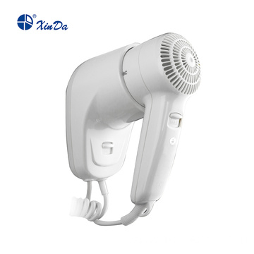 Push-button hair dryer with safety switch