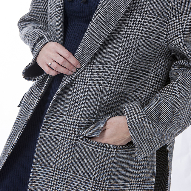 Sleeves of grey striped cashmere winter coat