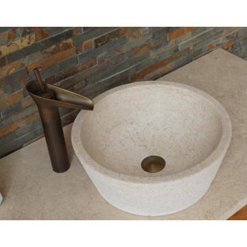 Round beige travertine sink