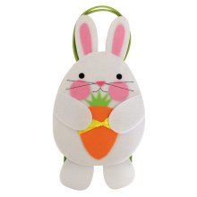 Easter bunny embraces carrot  candy gift bag