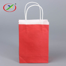 white kraft paper shopping bag with handle