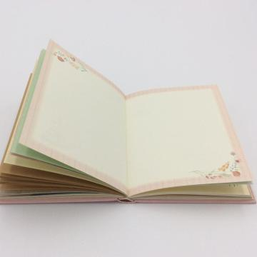 Paper notebook with colorful page