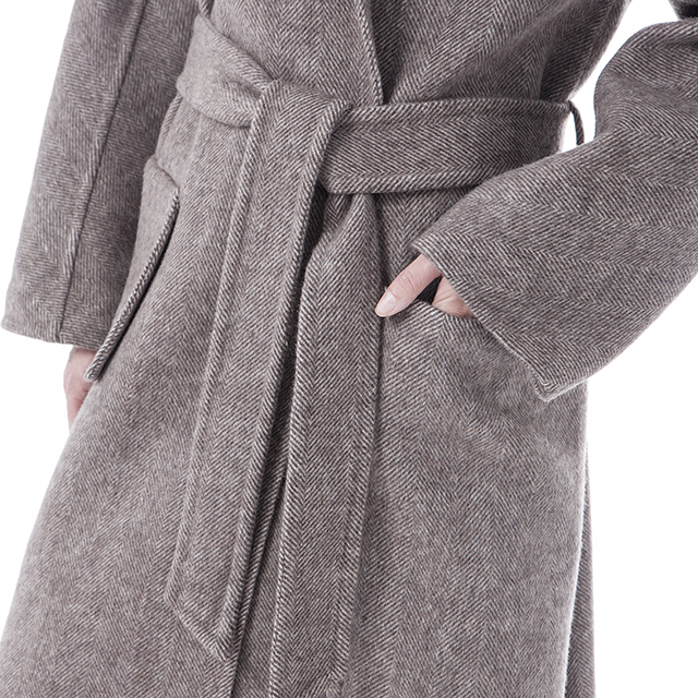 Underneath a cashmere overcoat