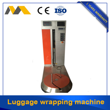 Airport baggage wrapping machine for protecting baggage from damage