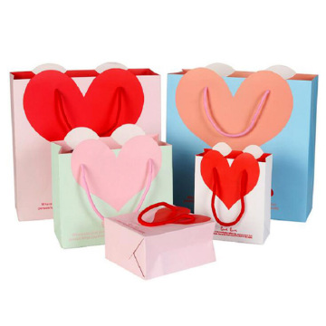 With heart-shaped gift hand-held paper bag