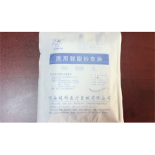 Single use medical degreasing gauze block