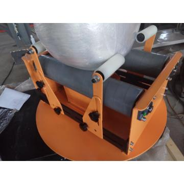 Small reel wrapping machine