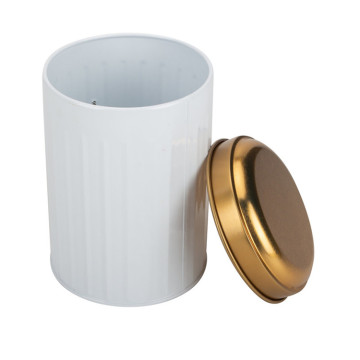 White and golden kitchen canister