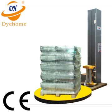 Stretch film pallet wrapping machine with weight system