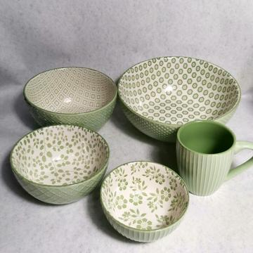 Stoneware items in embossed glaze