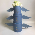 Round flower box with angel's wings