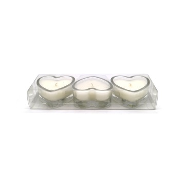White tealight candles in metal holders