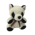 Plush Raccoon With Ribbon