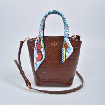 Small tote bag with long shoulder strap