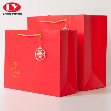 Gift paper shopping bag with gold twist handle