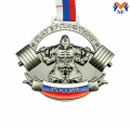 Silver metal weightlifting award medal