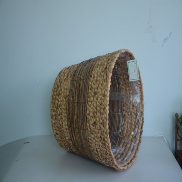 Round water hyacinth braid and banana leaf storage